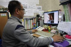 "In this Nov. 20, 2012 photo, Moon Tae-hwa, a devout Christian and family counselor, uses a desktop computer to hunt down online pornography at his office in Seoul, South Korea. Moon is among the most successful members of the ""Nuri Cops"" (roughly ""net cops""), a squad of nearly 800 volunteers who help government censors by patrolling the Internet for pornography in their spare time. (AP Photo/Ahn Young-joon)"