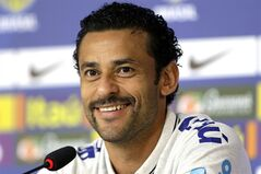 Brazil's Fred smiles during a news conference at the Granja Comary training center in Teresopolis, Brazil, Thursday, June 26, 2014. Brazil will face Chile in their next World Cup soccer match, Saturday. (AP Photo/Andre Penner)