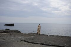 A Russian tourist stands on a Black Sea beach about 35 km. (22 miles) from Yalta, Crimea, Sunday, June 15, 2014. When Russia annexed the Black Sea peninsula of Crimea earlier this year, it regained not only harbors for its navy and abandoned Ukrainian military bases but also long stretches of pebble beaches that were the summer destination of choice for millions of Soviet citizens. The Kremlin is hoping to attract tourists to Crimea, which Russia annexed in March, by asking state-controlled companies to send their employees on free vacation trips.(AP Photo/Andrew Lubimov)