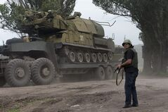 CORRECTS SPELLING OF TOWN TO SLOVYANSK Ukrainian government forces maneuver antiaircraft missile launchers Buk as they are transported north-west from Slovyansk, eastern Ukraine Friday, July 4, 2014. (AP Photo/Dmitry Lovetsky)