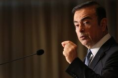 Nissan Chief Executive Carlos Ghosn speaks during a press conference at Foreign Correspondents' Club of Japan in Tokyo, Thursday, July 17, 2014. Ghosn, who has long made a point of promoting women to management positions, said the Japanese Prime Minister Shinzo Abe's plan to boost female bosses to 30 percent by 2020 is too ambitious. The participation of women in Japan's workforce is very low by developed nation standards. Women make up 2.9 percent of manager-level and higher positions at Japanese companies employing 5,000 or more people. (AP Photo/Eugene Hoshiko)