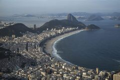 This aerial photo shot through an airplane window shows a view of the Copacabana beach and neighborhood, in Rio de Janeiro, Brazil, Tuesday, May 13, 2014. As opening day for the World Cup approaches, people continue to stage protests, some about the billions of dollars spent on the World Cup at a time of social hardship, but soccer is still a unifying force. The international soccer tournament will be the first in the South American nation since 1950. (AP Photo/Felipe Dana)