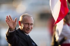 Russia's President Vladimir Putin waves to photographer as he leaves the Itamaraty Palace after attending the final day of the BRICS Summit in Brasilia, Brazil, Wednesday, July 16, 2014. (AP Photo/Felipe Dana)