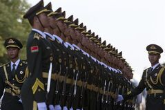 A guard of honor forms up before a welcome ceremony for Zimbabwe's President Robert Mugabe outside the Great Hall of the People in Beijing, China, Monday, Aug. 25, 2014. (AP Photo/Ng Han Guan)