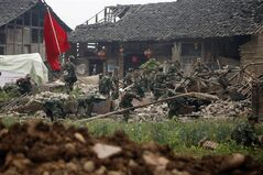 Rescue workers search through the rubble of a building destroyed by an earthquake in Qingyuan village of Baoxing county in southwestern China's Sichuan province, Monday, April 22, 2013. The efforts under way Monday in mountainous Sichuan province after a quake Saturday that killed at least 188 people showed that the government has continued to hone its disaster reaction — long considered a crucial leadership test in China — since a much more devastating earthquake in 2008, also in Sichuan, and another one in 2010 in the western region of Yushu. (AP Photo)