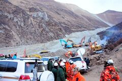 In this photo provided by China's Xinhua News Agency, rescuers work at the site where a landslide hit a mining area in Maizhokunggar County of Lhasa, capital of southwest China's Tibet Autonomous Region, Saturday, March 30, 2013. Rescuers in mountainous Tibet digging for victims of the massive landslide at a gold mining site found one body Saturday, a day after 83 workers were buried in the disaster, Chinese state media reported. The fate of the other victims was unknown. (AP Photo/Xinhua, Zhang Quan) NO SALES