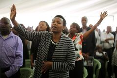 Friends and relatives of Mbugua Mwangi and his fiancee Rosemary Wahito attend their funeral service in Nairobi, Kenya, Friday Sept. 27, 2013. Mwangi, who is Kenyan President Uhuru Kenyatta's nephew, and Wahito died in the Westgate Mall attack that killed more than 60 people. (AP Photo/Jerome Delay)