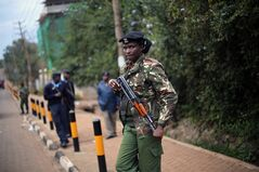 Kenyan security forces keep guard as Kenya's Interior Minister Joseph Ole Lenku addresses a press conference near the Westgate Mall in Nairobi, Kenya Wednesday Sept. 25 2013. At least 18 foreigners were killed when the militants entered the Westgate Mall on Saturday, slaughtering men, women and children with assault rifles and grenades and taking people hostage. The current death toll is 67 and is likely to climb with uncounted bodies remaining in the rubble. (AP Photo/ Jerome Delay)
