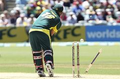 Australia's Aaron Finch is bowled by England's Stuart Broad during their one-day international cricket match in Adelaide, Australia, Sunday, Jan. 26, 2014. (AP Photo/James Elsby)