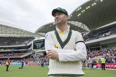 Australia's Michael Clarke smiles after beating England during the fifth day of the second Ashes cricket test match between England and Australia, in Adelaide, Australia, Monday, Dec. 9, 2013.(AP Photo/James Elsby)