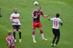 Bayern's Bastian Schweinsteiger, center, Stuttgart's Daniel Schwaab, left, and Carlos Armando Gruezo challenge for the ball during the Bundesliga soccer match between FC Bayern Munich and VfB Stuttgart in the Allianz Arena in Munich, Germany, on Saturday, May 10. 2014. (AP Photo/Kerstin Joensson)