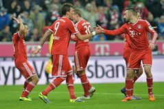 Munich's players celebrate after scoring during the German first division Bundesliga soccer match between FC Bayern Munich and Hamburger SV in Munich, Germany, Saturday, Dec. 14, 2013. (AP Photo/Kerstin Joensson)