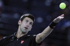 Novak Djokovic of Serbia serves the ball to Denis Istomin of Uzbekistan during the second round of the Dubai Duty Free Tennis Championships in Dubai, United Arab Emirates, Tuesday, Feb. 25, 2014. (AP Photo/Kamran Jebreili)