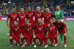 FILE- In this June 13, 2012 file photo, Portugal soccer team poses prior to the start the Euro 2012 soccer championship Group B match between Portugal and the Netherlands in Kharkiv, Ukraine. Background from left: Nani, Helder Postiga, Bruno Alves, Pepe, Cristiano Ronaldo and Rui Patricio. Foreground from left: Joao Moutinho, Fabio Coentrao, Raul Meireles, Joao Pereira and Miguel Veloso. (AP Photo/Armando Franca, File) - SEE FURTHER WORLD CUP CONTENT AT APIMAGES.COM