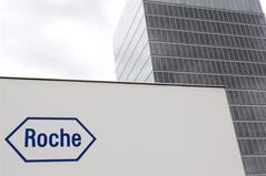 FILE - In this June 6, 2011 file picture the logo of Swiss company Roche is photographed in Rotkreuz, Switzerland. Swiss drugmaker Roche Holding AG on Thursday July 24, 2014 posted a net profit drop of 7 percent compared with a year ago, weighed down by a strong Swiss franc and charges from one of its diagnostic units. (AP Photo/Keystone,Urs Flueeler,File)