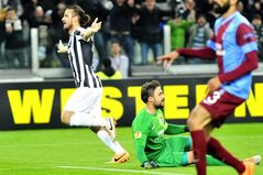 Juventus forward Pablo Osvaldo celebrates after scoring during the Europa League, Round 16th, soccer match between Juventus and Trabzonspor at the Juventus stadium, in Turin, Italy, Wednesday, Feb. 20, 2014. (AP Photo/Massimo Pinca)