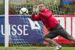 FILE - In this Oct. 10, 2012 file picture Swiss national soccer goalie Diego Benaglio saves the ball during a practice session in Jona, Switzerland . Switzerland goalkeeper Diego Benaglio says he is retiring from international football aged 30. Benaglio went to three World Cups and was Switzerland's first-choice 'keeper in 2010 and in Brazil. His 61st and final international was during the 1-0 loss to Argentina in the Round of 16. Wednesday's Aug. 20, 2014 announcement comes days after FIFA's World Cup technical report praised Bengalio among the