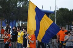 A fan of the Cyprus soccer team APOEL holds his team flag as he and other fans take part in a demonstration outside of the Cyprus Football Association in capital Nicosia, Cyprus, Tuesday, May 27, 2014. Hundreds of APOEL fans have staged a peaceful protest outside the Cyprus Football Association's headquarters over a decision to replay the season's abandoned final soccer match between the Nicosia team and rival AEL Limassol that would have decided the championship. (AP Photo/Petros Karadjias)
