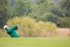Paraguay's Fabrizio Zanotti watches his shot during the BMW International Open golf tournament in Pulheim near Cologne, Sunday June 29, 2014. (AP Photo/dpa, Rolf Vennenbernd)