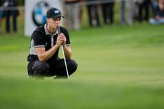 Germany's Martin Kaymer concentrates during the BMW International Open golf tournament in Pulheim near Cologne, Germany, Friday June 27, 2014. (AP Photo/dpa,Rolf Vennenbernd)