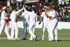 South African players celebrate the wicket of Zimbabwean batsman Tinashe Panyangara, after he was caught behind for 12 runs during the Test match against South Africa at Harare Sports club, Saturday, Aug. 9, 2014. Zimbabwe won the toss and elected to bat on the first day of the one off test against South Africa in Harare. (AP Photo/Tsvangirayi Mukwazhi)