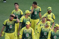 Australian cricket players walk off the pitch after they lost to South Africa by 7 wickets at the end of the cricket One Day International match against South Africa in Harare Zimbabwe, Wednesday, Aug. 27, 2014. The two teams are in Zimbabwe for a triangular ODI series with Zimbabwe. (AP Photo/Tsvangirayi Mukwazhi)