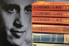 FILE - In this Jan. 28, 2010 file photo, a photo of J.D. Salinger appears next to copies of his classic novel