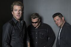 Country super-group Rascal Flatts (left to right) Joe Don Rooney, Gary LeVox and Jay DeMarcus pose for a photograph in a Toronto hotel as they promote their eighth album 'REWIND' on Thursday, May 22 , 2014. THE CANADIAN PRESS/Chris Young