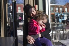 Liz Gavin Kerr sits with her three-year-old daughter Isla in a Toronto coffee shop on Wednesday February 19, 2014. Isla had surgery to treat a brain tumour, but doctors at Sick Kids Hospital are finding that a brain tumour that affects babies and toddlers might be treatable with an existing drug. THE CANADIAN PRESS/Chris Young