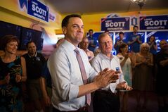 Ontario PC Leader Tim Hudak (left) stands with local candidate Larry Scott at a campaign rally in Oakville, Ont. on Tuesday June 10, 2014, as he continues his election campaign. THE CANADIAN PRESS/Chris Young