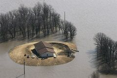 A house just just north of Morris, Man. is isolated by floodwater Tuesday April 14, 2009. This month's heavy snowfall on the Prairies has the Manitoba government warning that major flooding is possible this spring.THE CANADIAN PRESS/John Woods