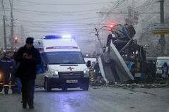 In this Dec. 30, 2013 photo an ambulance leaves the site of an explosion after a bomb blast in Volgograd. THE CANADIAN PRESS/AP, Denis Tyrin