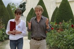 In this film publicity image released by Sony Pictures Classics, Carla Bruni, left, and Owen Wilson are shown in a scene from,