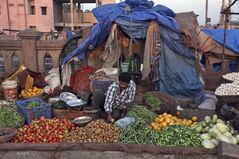 An Indian vendor sorts vegetables as he waits for customers in Hyderabad, India, Jan. 2, 2014. THE CANADIAN PRESS/AP, Mahesh Kumar A.