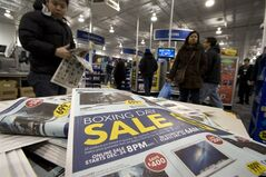 Shoppers hunt for early morning Boxing Day bargains at a suburban electronics store in Toronto on Wednesday, December 26, 2012. THE CANADIAN PRESS/Frank Gunn