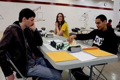 Paul Ross (left) from John Taylor Collegiate watches DMCI's Dylan Beardy make his move.