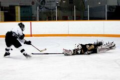 Gophers goaltender Derrick Vinsky makes a diving pokecheck to stop a breakaway chance.