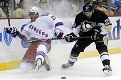 New York Rangers' Ryan McDonagh (27) slides into the boards after colliding with Pittsburgh Penguins' Lee Stempniak (22) in the second period of Game 1 of a second-round NHL hockey playoff series in Pittsburgh, Friday, May 2, 2014. THE CANADIAN PRESS/AP/Gene J. Puskar