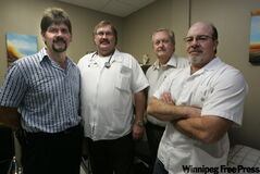 Pictured above, from left, Dr. Johan Jacobs, Dr. Dan Gerber, Dr. Wilhelm Grobler and Dr. Louis Van Rooyen aren't happy with the WRHA's decision not to priori­tize doctors to get the H1N1 vaccine.