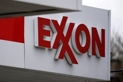An Exxon sign is pictured at a Exxon gas station in Carnegie, Pa. on April 29, 2014. THE CANADIAN PRESS/AP, Gene J. Puskar