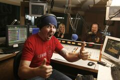 Power 97 morning host Dave Wheeler gives the two thumbs up for his on air partners Philly and Rena (rear) in their Portage Avenue studio in this 2010 photo. The trio resigned Wednesday.