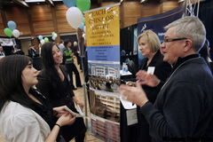 Recruitment consultants Errol and Donna Harris (right) speak with Stacey Matsumoto (far left) and Joelynn Tyschinski at Education Exposition 2010 at the University of Manitoba on Monday.