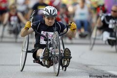 A participant in the wheelchair race at the Manitoba Marathon leaves the University of Manitoba this morning.