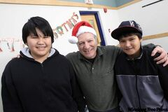 Phil Chiappetta with Ronald Gabriel, 13, (left) and Desmond Harper, 12,  who attend Rossbrook House's alternative school program.