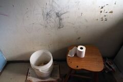 A pail is used for a toilet in an unplumbed home on Wasagamack First Nation at Island Lake.