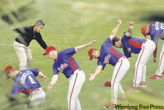 Phillies conditioning co-ordinator Dong Lien leads the squad through warm-up drills during spring training in Clearwater, Fla.