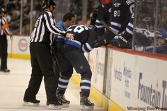 Winnipeg Jets' Blake Wheeler is helped off the ice after he was injured in the second period during Saturay's game against the New Jersey Devils.  The Devils won the game 2 to 1.
