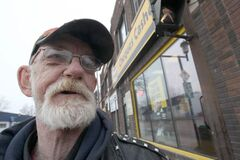 James Jackson 58, cashes his cheques at Money Mart on Selkirk Avenue: