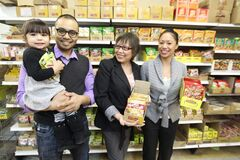 Carmen Bueno (centre), with her children, Patrick and Eliza Bueno, and granddaughter, Xahra, at the family's supermarket, one of the oldest Filipino-owned businesses in Winnipeg.