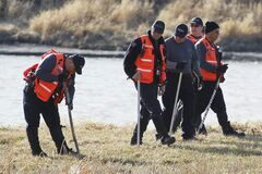 RCMP Search and Rescue search the east bank of the Red River just north of the Highway 4 bridge last Sunday after remains were found in the area.